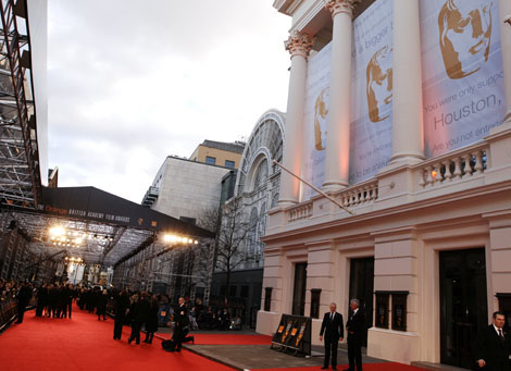 The red carpet is prepared outside the Royal Opera House.