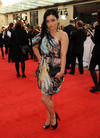 The EastEnders star is wearing Matthew Williamson from our Official Stylist WishWantWear. (Pic: BAFTA/Richard Kendal)