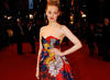 Actress Romola Garai poses on the Film Awards red carpet in a flowery Erdem dress and Miu miu shoes (BAFTA/Richard Kendal).