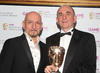 The design legend behind Dungeon Keeper, Theme Park and the Fable series, with Sir Ben Kingsley who recently voiced a character in Fable III. (Pic: BAFTA/Steve Butler)