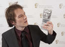 Will Anderson with his award for Animation