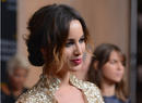 French actress Berenice Marlohe, star of 2012 Bond film Skyfall, looked stunning in gold.