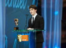 Harry Potter star Daniel Radcliffe on stage to present the Award for Outstanding British Contribution to Cinema (pic:BAFTA / Camera Press).