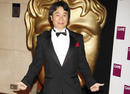 Gaming legend Shigeru Miyamoto arrives at the Awards to receive the Academy's highest honour, the Fellowship.