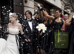 Outside BAFTA's wedding venue, guests throw confetti