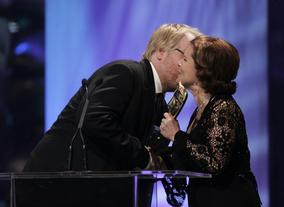 Philip Seymour Hoffman accepts his BAFTA from Imelda Staunton.