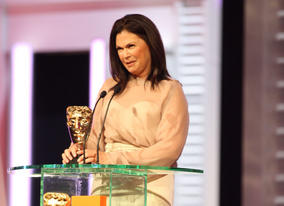 Colleen Atwood accepts the BAFTA for her work on Alice In Wonderland.