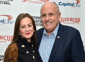 Judith Nathan (L) and Rudy Giuliani attend the 21st Annual Hamptons International Film Festival on October 12, 2013 in East Hampton, New York. (Photo by Eugene Gologursky/Getty Images for The Hamptons International Film Festival)