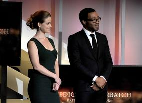Alice Eve and Chiwetel Ejiofor watch on as Benedict Cumberbatch delivers his acceptance speech