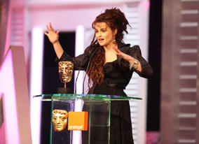 Helena Bonham Carter accepts the BAFTA for her role in The King's Speech.