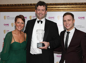 David Tyler is joined by Olly Murs and Game's Lisa Morgan after the British public voted Call of Duty: Modern Warfare 2 their favourite title of the last year in the Game Award 2009 (BAFTA/Steve Butler).