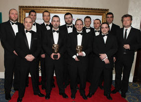 The developpment team behind Batman: Arkham Asylum, including Sefton Hill and Jamie Walker, proudly display the coveted Best Game BAFTA (BAFTA/Steve Butler).