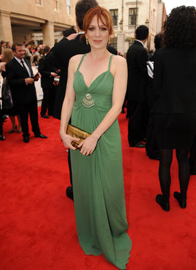 Her elegant, full-length gown in a soft shade of sage green that beautifully compliments her autumnal colouring. Her slim figure suits this empire line style, which must be avoided at all costs if you have a tummy, as it can look like a maternity dress. Katherine however, looks glamorous and refined. The length of the dress elongates her and the soft, lightly gathered fabric adds femininity.