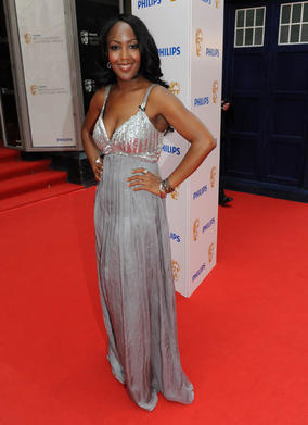 Angellica Bell has cleverly chosen a dress with a deep V neckline that emphasises her bust. The sequined top also adds a touch of sparkle and glamour to the look. The empire line of the dress cuts underneath her bust, fitting neatly around her smallest part and skimming her slim hips. This style gives a long lean look as the skirt starts high up under the bust and continues to the floor. Opt for a style like this if you are petite, as it will elongate you. The soft shade of silver works well with Angellica's warm colouring. Avoid if you have a cool skin tone, or it could bring out the blue undertones in your skin.