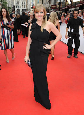 She looks effortlessly stylish in this long, black evening dress. It has enough structure to show her great hourglass figure, and the one-shoulder neckline brings a classic style dress up to date. Black is such a great colour, as it always looks chic and classy, but watch out if you have a warm skin tone, as black can be draining. Try opting for a dark navy or midnight blue as an alternative.
