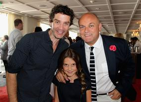 Actor James Frain and actress Millie Brown with BAFTA LA board member Nigel Daly