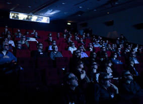 Audience members don glasses for a demonstration of cutting-edge 3D technology.