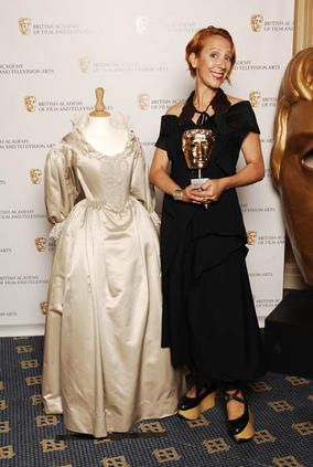 Michele Clapton, winner of  the Costume Design Award for The Devil's Whore, poses with one of her BAFTA-winning creations (BAFTA / Richard Kendal).