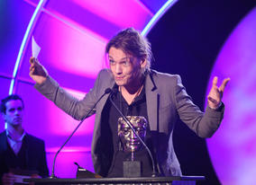 Actor Jamie Campbell Bower - known for his role in Sweeney Todd and as Gellert Grindelwald in Harry Potter and the Deathly Hallows - presents the Feature Film Award.