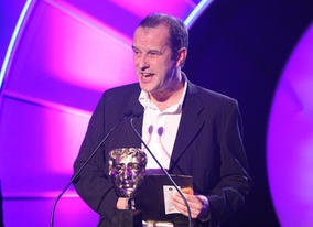 Dead Ringers actor Phil Cornwell presents the Entertainment category.