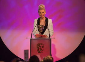 Fresh from treading the boards of Shrek: The Musical, Hollyoaks actress and West End star Stensen presents the Performer Award.