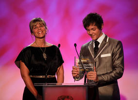 Tyger Drew Honey, star of Outnumbered and BAFTA Young Game Designers ambassador, presents the Game-making Award with Maria Stukoff of Sony.