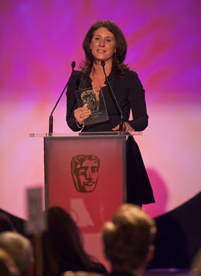 Disney's Tricia Wilber with the BAFTA Kids' Vote award for TV show Good Luck Charlie.