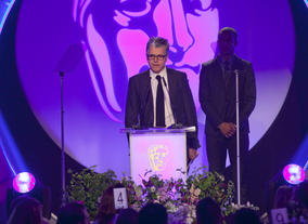 The Original Music BAFTA is won by Brian Eno for Top Boy. Show producer Alasdair Flint accept the award on his behalf.