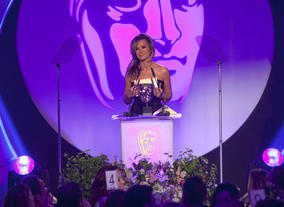 Kierston Wareing presents the Award for Make-Up and Hair Design.