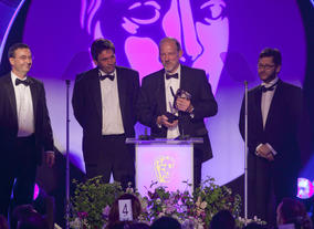 John Mooney, Jeremy Child, Howard Bargroff and Doug Sinclair pick up the BAFTA for Sound: Fiction.