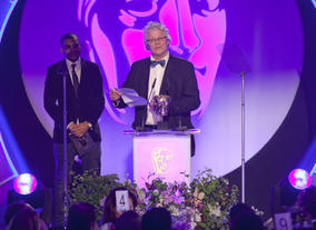 Neil McKay picks up the BAFTA for Break-Through Talent on behalf of Kwadjo Dajan who was unable to pick up the Award in person. Kwadjo won the Award as co-producer on Appropriate Adult.