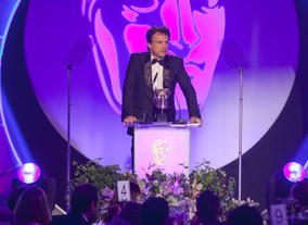 Jonathan Firth presents the award for Director: Fiction sponsored by Production Base.