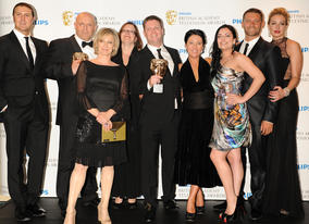 Paddy McGuinness and Cat Deeley presented the production team behind the popular BBC soap EastEnders with the BAFTA for Continuing Drama. (Pic: BAFTA/Richard Kendal)