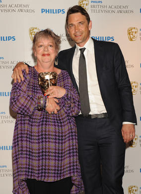 Dougray Scott presented Jo Brand with the BAFTA for Female Performance in a Comedy Programme, for her role as Nurse Kim Wilde in Getting on. (Pic: BAFTA/Richard Kendal)