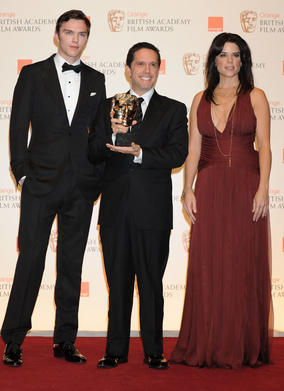 Nicholas Hoult and Neve Campbell with Animated Film winner Lee Unkrick. (Pic: BAFTA/ Richard Kendal)