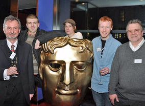 BAFTA Mentors John McShane (left) and Jerry Brannigan (right) with young scriptwriters from Glasgow Youth Film Festival.