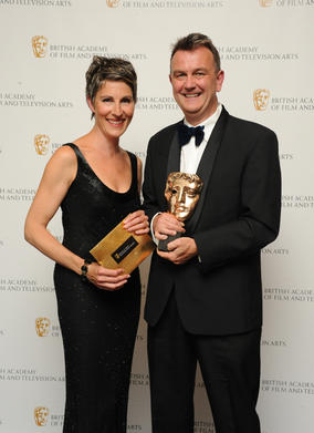 BAFTA-winning writer Peter Bowker with presenter Tamsin Greig. (Pic: BAFTA/Chris Sharp)