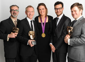 Olympic rower Heather Stanning with the winning team behind Share A Story 2011, including Dave Hickman, Carl Hadley and David Heslop.