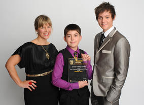 Thirteen-year-old Christopher Purdy, who won the BAFTA Young Game Designers Game-Making Award presented by Sony Computer Entertainment Europe for his game Smiley Dodgems. Pictured here with Maria Stukoff (Sony) and Tyger Drew Honey.
