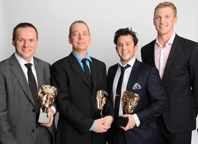 Presenter Alex Gregory with Video Game winners Paul Reiche, Roy Stackhouse and Ian McClellan for Skylanders Spyro's Adventure.
