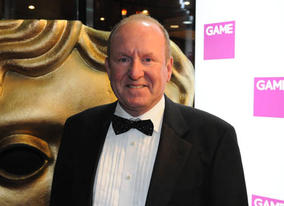 Industry legend Ian Livingstone, the co-writer of the first Fighting Fantasy gamebook and co-founder of Games Workshop, arrives to present BAFTA in the Artistic Achievement category (BAFTA / James Kennedy).