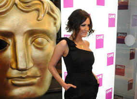 Television Presenter Caroline Flack steps off the red carpet at the London Hilton Hotel (BAFTA / James Kennedy).