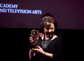 Delia shows off her BAFTA Special Award