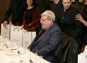 Sir Alan Parker takes his seat at the table.