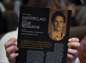 A guest reads about Eddie Redmayne before his masterclass