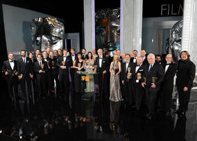 All of the evening's winners pose with host Jonathan Ross (right) to mark the 64th Orange British Academy Film Awards