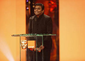 The proceedings start as they mean to go on with A R Rehman picking up the first of seven BAFTAs for Slumdog Millionaire (BAFTA / Marc Hoberman).