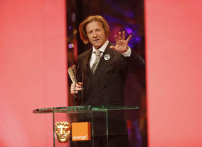 Anthony Dod Mantle accepts the Cinematography Award - the fourth of the night for Slumdog Millionaire (BAFTA / Marc Hoberman).