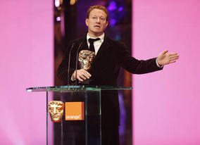 And the BAFTA goes to... Slumdog Millionaire makes it five BAFTAs for the first nine categories as Simon Beaufoy collected the Adapted Screenplay Award (BAFTA / Marc Hoberman).