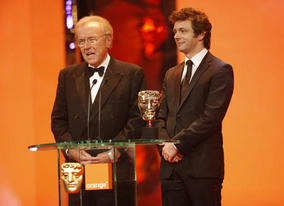 David Frost met his match on stage as he joined his film double Michael Sheen to present the Original Screenplay Award (BAFTA / Marc Hoberman).